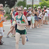 Record-Eagle/Keith King<br /> Nicole Sifuentes finishes first in the elite women division of the Golden Mile Thursday, July 4, 2013 during the 87th National Cherry Festival in Traverse City.