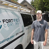 Record-Eagle/Keith King<br /> Skyler Fort, owner of Fortified Coatings, stands Thursday, June 27, 2013 at a job site in Leland.