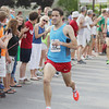 Record-Eagle/Keith King<br /> Daniel Clark finishes first in the elite men division of the Golden Mile Thursday, July 4, 2013 during the 87th National Cherry Festival in Traverse City.