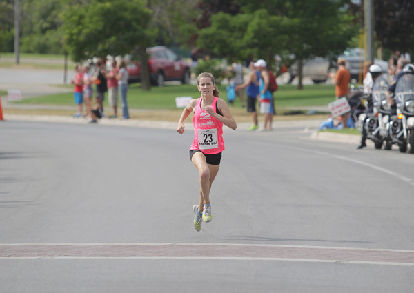 Record-Eagle/Keith King<br /> Erin Finn finishes first in the high school girls division of the Golden Mile Thursday, July 4, 2013 during the 87th National Cherry Festival in Traverse City.