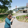 Record-Eagle/Keith King<br /> Meggen Watt Petersen, owner of Meggen Watt Photography, takes pictures Thursday, June 27, 2013 during a job at The Leland Lodge.