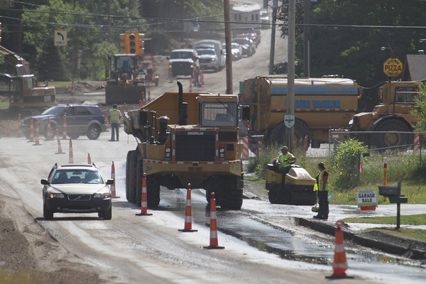 Record-Eagle/Keith King<br /> Work takes place Friday, June 28, 2013 on the Holiday Road reconstruction project.