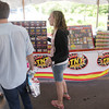 Record-Eagle/Keith King<br /> Kali Markham explains the characteristics of different fireworks to potential customers Friday, June 28, 2013 at the TNT Fireworks tent at the Meijer parking lot in Traverse City. Proceeds from the sale of the fireworks go toward the Redeeming Grace Church Youth Group, of which Markham is a member.