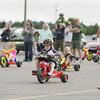 Record-Eagle/Keith King<br /> Owen Adams, 6, of Traverse City, takes part in the Kids' Big Wheel Race at the Grand Traverse Mall Saturday, June 29, 2013 during the 87th annual National Cherry Festival.