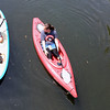 Record-Eagle/Tessa Lighty <br /> Kia Lloyd, left, talks to her friend Shelby Borst, right, as they cruise down the Boardman River.