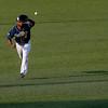 Record-Eagle/Jan-Michael Stump <br />  Traverse City Beach Bums left fielder Brandon Jacobs fields a grounder from Gateway Grizzlies left fielder Cody Livesay Wednesday night at Wuerfel Park.