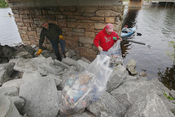 Record-Eagle/Keith King<br /> Volunteers Dave Mathews, left, and Jeff Watts, both of Traverse City, with others, pick up trash along the Boardman River Saturday, June 8, 2013 during the annual Boardman River Clean Sweep cleanup.