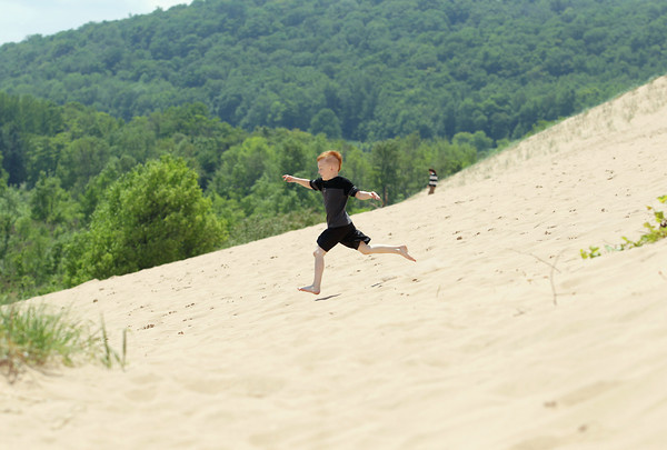 Record-Eagle/Keith King<br /> Didier Ramoie, 6, of Grand Rapids runs Monday, June 10, 2013 at the Sleeping Bear Dunes National Lakeshore Dune Climb in Glen Arbor Township.