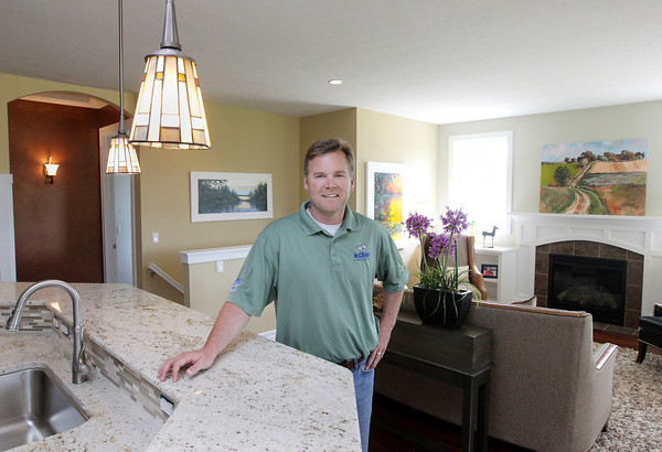 Record-Eagle/Keith King<br /> Sean McCardel, owner of Sean McCardel Construction, as well as a Certified Green Professional (CGP) and Certified Graduate Builder (CGB), stands Thursday, June 6, 2013 in a new house built by Sean McCardel Construction in the Verndale at East Bay neighborhood in East Bay Township. The house will be in the 2013 Parade of Homes.