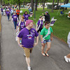 Record-Eagle/Keith King<br /> Steven Sanford, from left, Tina Preston and Joelle Mabey, all of Traverse City, cancer survivors, along with other cancer survivors and participants, walk Saturday, June 8, 2013 at the start of the 2013 American Cancer Society Relay for Life at the Grand Traverse County Civic Center.