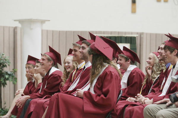 Record-Eagle/Keith King<br /> Graduating seniors laugh while watching their senior video Saturday, June 8, 2013 during the Traverse City Christian High School commencement at Traverse City Christian School.