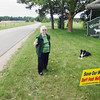 "Record-Eagle/Keith King<br /> Phyllis Senske, of Rapid River Township, stands in her yard, next to her dog, JJ, Wednesday, June 12, 2013 near a hydraulic fracturing site, end of road in back. ""I grew up here. We always had clean, fresh water,"" Senske said. ""It never occurred to me that they'd drill and end up in our aquifer,"" Sense said."