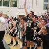 Record-Eagle/Keith King<br /> Glen Lake head coach, Todd Hazelton, left, and players, celebrate after Logan LaCross (42) scores a basket to send the Class C regional final game against Shelby into overtime Wednesday, March 13, 2013 at Traverse City West High School.