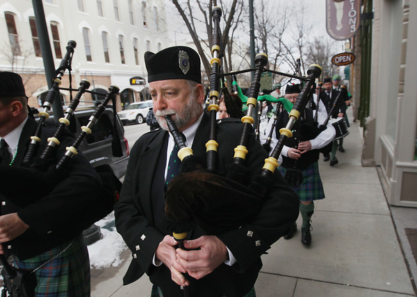 Record-Eagle/Keith King<br /> Jack Fellows plays the bagpipes as the Grand Traverse Pipes and Drums march through downtown Traverse City Friday, March 15, 2013 during the annual Traverse City St. Patrick's Day Pub Walk.