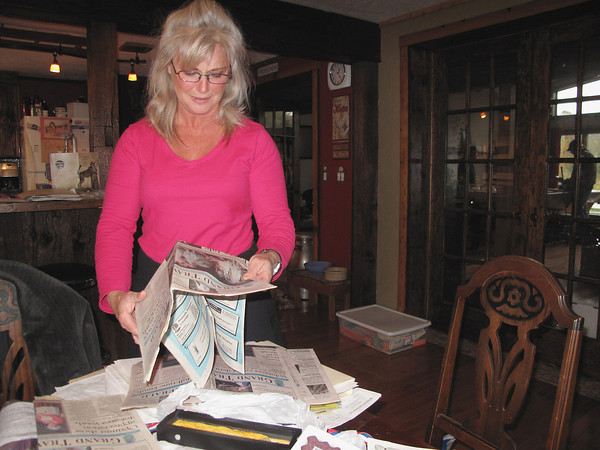Record-Eagle/Glenn Puit<br /> <br /> Pam Hoyt goes through some of her most precious belongings – mementos of her son's childhood – that were badly damaged when water swamped her property on Boardman Plains Road.