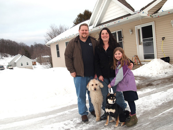 Record-Eagle/Brian McGillivary<br /> Rising property assessments pleased Seth and Lauren Rousseau because it means the value of their Blair Township home has increased. The Rousseaus, their 8-year-old daughter Lauryn and their two dogs moved into the area two years ago. Township officials credit the renewed interest of young home buyers in the township with reversing a four-year decline in property values.