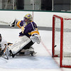 Record-Eagle/Keith King<br /> <br /> Traverse City Central's Cooper Macdonell (7) scores a goal against Warren De La Salle goalie Joey Lopezzi Saturday, November 24, 2012 at Centre ICE.