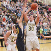 Record-Eagle/Keith King<br /> Glen Lake's Mike O'Brien shoots the ball against Lincoln-Alcona Monday, March 11, 2013 at Traverse City West High School.