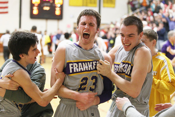Record-Eagle/Keith King<br /> Frankfort's Connor Bradley (10), from left, Owen Stratton (23) and David Loney (20) celebrate after winning against Baldwin Monday, March 11, 2013 at Traverse City Central High School.