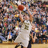 Record-Eagle/Keith King<br /> Glen Lake's Carter Lee (32) puts the ball up against Lincoln-Alcona Monday, March 11, 2013 at Traverse City West High School.