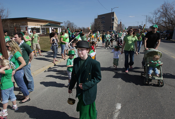 Record-Eagle/Keith King<br /> Eamonn McGonigle, 11, of Interlochen, travels along Front Street Saturday, March 17, 2012 toward the conclusion of the annual Traverse City St. Patrick's Day Parade.
