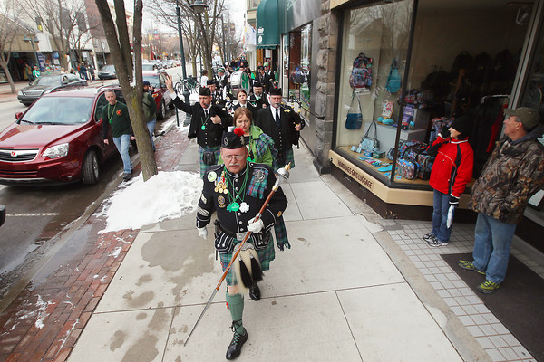 Record-Eagle/Keith King<br /> Les Thornburg, drum major, leads the Grand Traverse Pipes and Drums through downtown Traverse City toward Union Street Station Friday, March 15, 2013 during the annual Traverse City St. Patrick's Day Pub Walk.