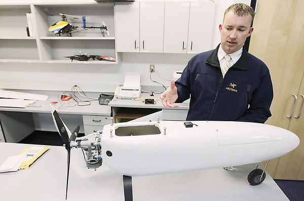 Record-Eagle/Keith King<br /> Aaron Cook, Northwestern Michigan College aviation program director, speaks about an unmanned aerial vehicle (UAV) in the Parsons-Stulen Building on the Aero Park Campus of NMC.