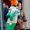 "Record-Eagle/Jan-Michael Stump<br /> Carmen Bourne of Traverse City carries her inflatable leprechaun, ""Joseph"" down Union Street during Thursday's St. Patrick's Day Pub Crawl in downtown Traverse City."