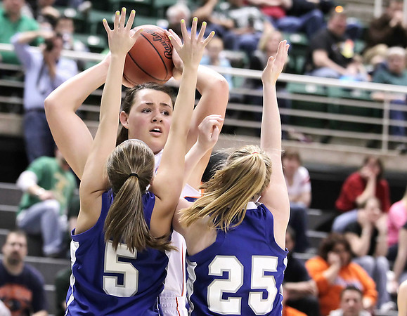 Record-Eagle/Keith King<br /> Central Lake's Jasmine Hines is heavily defended by Waterford Our Lady of the Lakes Thursday, March 17, 2011 during the Class D state semifinal game in East Lansing.