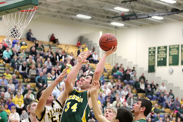 Record-Eagle/Keith King<br /> McBain's Nathan Smith (34) takes a shot against Lincoln-Alcona on Wednesday.
