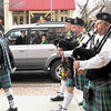 Record-Eagle/Jan-Michael Stump<br /> Heidi Mellow and her daughters Lily, 9, and Tess, 11, find a perfect vantage point to watch, right from their car, as members of the Grand Traverse Pipes and Drums march down Front Street during Thursday's St. Patrick's Day Pub Crawl through Traverse City. The annual event begins at noon and makes one-hour stops at 10 downtown restaurants and bars.