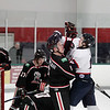 Record-Eagle/Keith King<br /> The Traverse City North Stars' Alexander Taulien, right, and the Motor City Metal Jackets' Aaron Scheppelman get into a tussle Tuesday.