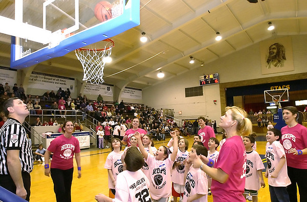Record-Eagle/Garret Leiva<br /> Holy Angels Elementary students take on their teachers in an exhibition game during the Katie Heintz Basketball Tournament at St. Francis High School gymnasium on Saturday. The tournament is a memorial for Heintz, a 16-year-old St. Francis student who died in 2005.