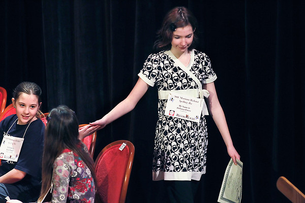 Record-Eagle/Jan-Michael Stump<br /> Delaney Peters, right, gets a high-five from Lydia Christian after being knocked out of the 2011 Grand Traverse Regional Spelling Bee Sunday at the City Opera House.
