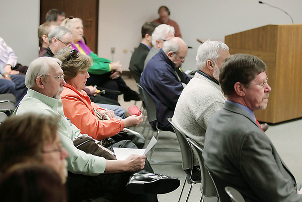 Record-Eagle/Keith King<br /> Attendees listen during a Grand Traverse County Board of Commissioners meeting on Wednesday at the Governmental Center in Traverse City.