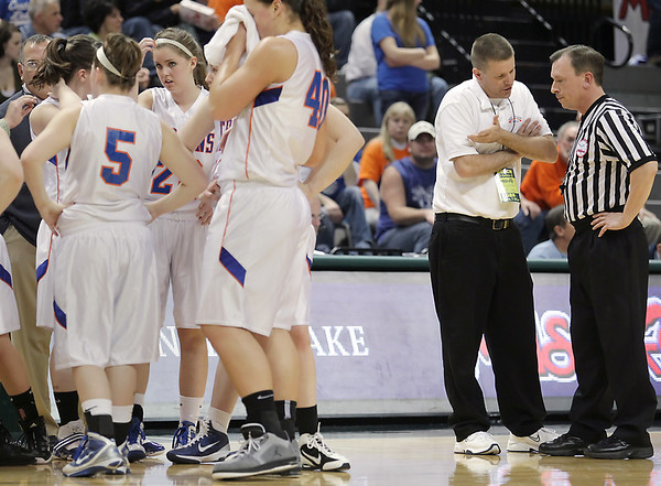Record-Eagle/Keith King<br /> Central Lake girls varsity basketball head coach, Al Becker, talks with an official during a timeout as his team plays against Waterford Our Lady of the Lakes Thursday, March 17, 2011 during the Class D state semifinal game in East Lansing.