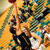 Record-Eagle/James Cook<br /> Gaylord's Lindsey Zaremba (14) goes up for two points Friday at Traverse City West.