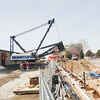 Record-Eagle/Keith King<br /> A crane is assembled on Garland Street in Traverse City so that it can be used at the Hotel Indigo construction site.