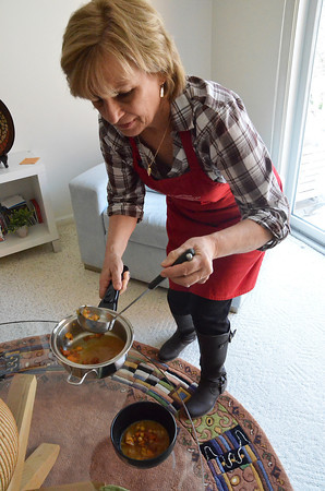 Record-Eagle/Allison Batdorff<br /> Sherry Davis, a Food for Life instructor, dishes up African bean soup at her Traverse City home.