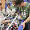 Record-Eagle/Keith King<br /> Jennifer Staley, from left, 17, Aaron Kaiser, 18, Matt Bennett, 17 and Tim Brownell, 17, all members of Titan Robotics, a Traverse City West High School robotics team, work on the team's robot during Traverse City FIRST (For Inspiration and Recognition of Science and Technology) Robotics District Competition at Traverse City Central High School.