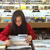 Record-Eagle/Nathan Payne<br /> Jill Murdock flipps through stacks of albums at RPM Records on Wednesday afternoon. The shop, with help from customers like Murdock, has ridden a surge of music fans returning to records.
