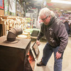 Record-Eagle/Keith King<br /> Dean VanSteenburg, of Grawn, closes the door to a stove after putting wood into it as people gather in his garage.