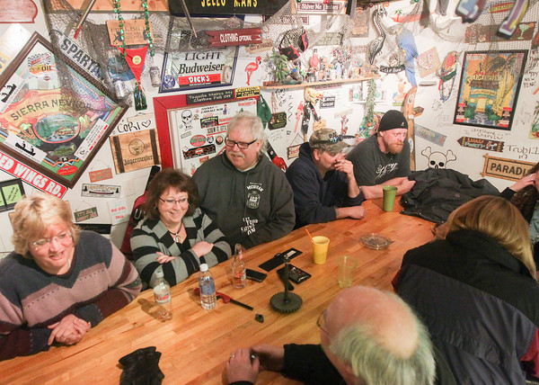 "Record-Eagle/Keith King<br /> Jill ""Rose"" Johnson, from left, of Traverse City, Karen and Dean VanSteenburg, of Grawn, Troy Kantz, of Kingsley and Tom McCann, of Traverse City, along with others, gather in the VanSteenburgs' garage Friday."
