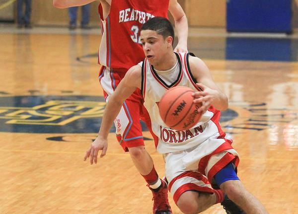 Record-Eagle/Keith King<br /> East Jordan's Noah Bacchus (10) dribbles the ball against Beaverton at Traverse City St. Francis High School.