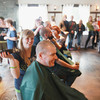 Record-Eagle/Keith King<br /> Jessica Michel, with Salon Saloon, finishes shaving the head of Mike Hall, master brewer with Northern United Brewing Company, Friday, March 15, 2013 during a head-shaving event at the Jolly Pumpkin to benefit the St. Baldrick's Foundation, a charity dedicated to raising money for childhood cancer research.