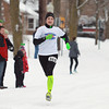 Record-Eagle/Keith King<br /> Alison Goss, of Traverse City, nears the finish line Saturday, March 16, 2013 during the Leapin' Leprechaun 5K in Traverse City. Goss won first in the women's division of the race.