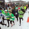 Record-Eagle/Keith King<br /> Runners take off from the starting line Saturday, March 16, 2013 during the Leapin' Leprechaun 5K in Traverse City.