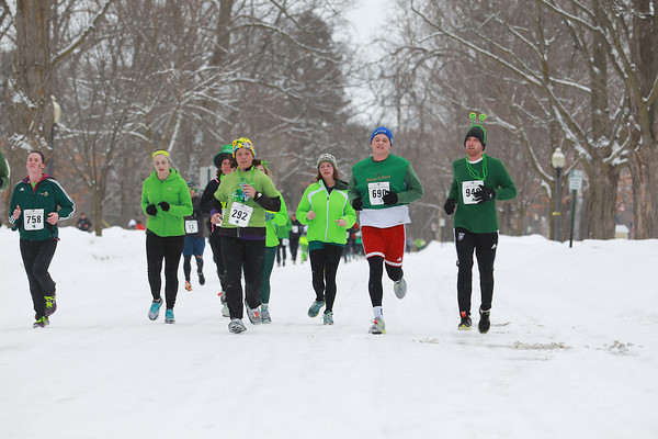Record-Eagle/Keith King<br /> Runners travel on Sixth Street Saturday, March 16, 2013 during the Leapin' Leprechaun 5K in Traverse City.