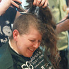 "Record-Eagle/Keith King<br /> Jayne Bronson-Kellogg, of Kingsley, has her hair cut Friday, March 15, 2013 during a head-shaving event at the Jolly Pumpkin to benefit the St. Baldrick's Foundation, a charity dedicated to raising money for childhood cancer research. ""It feels really great,"" Bronson-Kellogg said about her haircut."