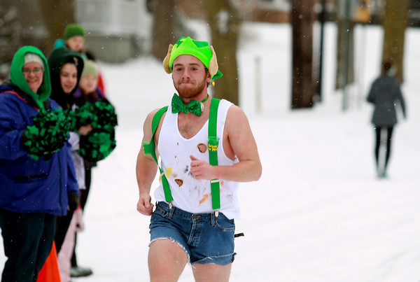 Record-Eagle/Keith King<br /> Jacob Secor, of Traverse City, nears the finish line Saturday, March 16, 2013 during the Leapin' Leprechaun 5K in Traverse City. Secor won first in the men's division of the race.